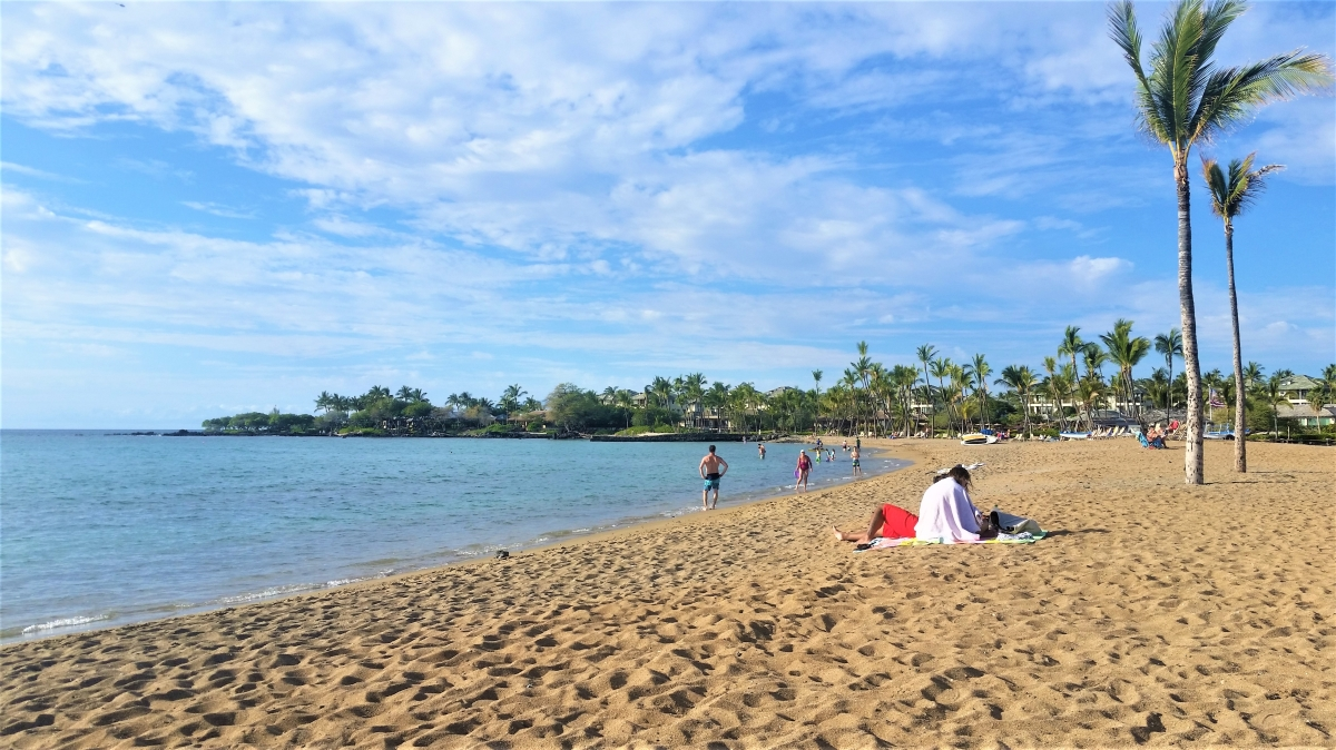 Relaxing on the beach at Anaeho'omalu Bay