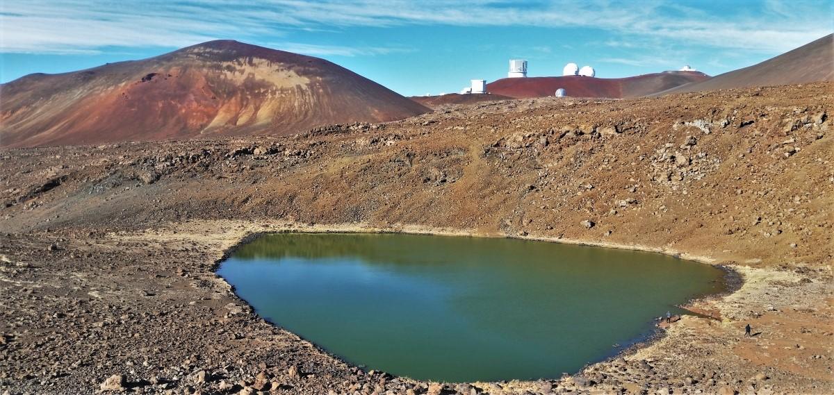 Mauna Kea Observatory visible just over the ridge from Lake Waiau