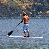 The calm bays on the Big Island make this a perfect place to learn stand up paddle boarding.