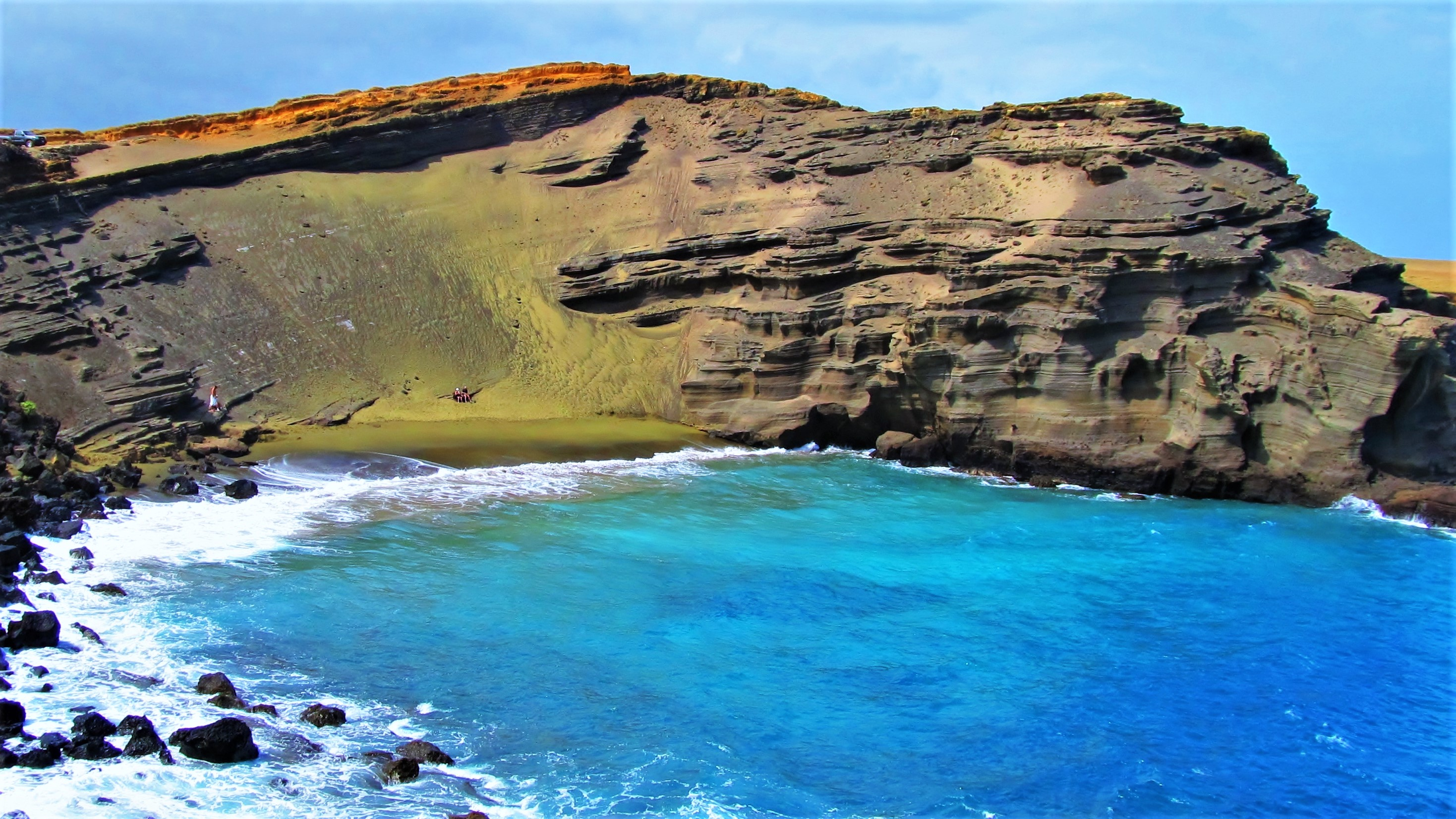Papakolea Green Sand Beach - one of many unique Hawaii attractions