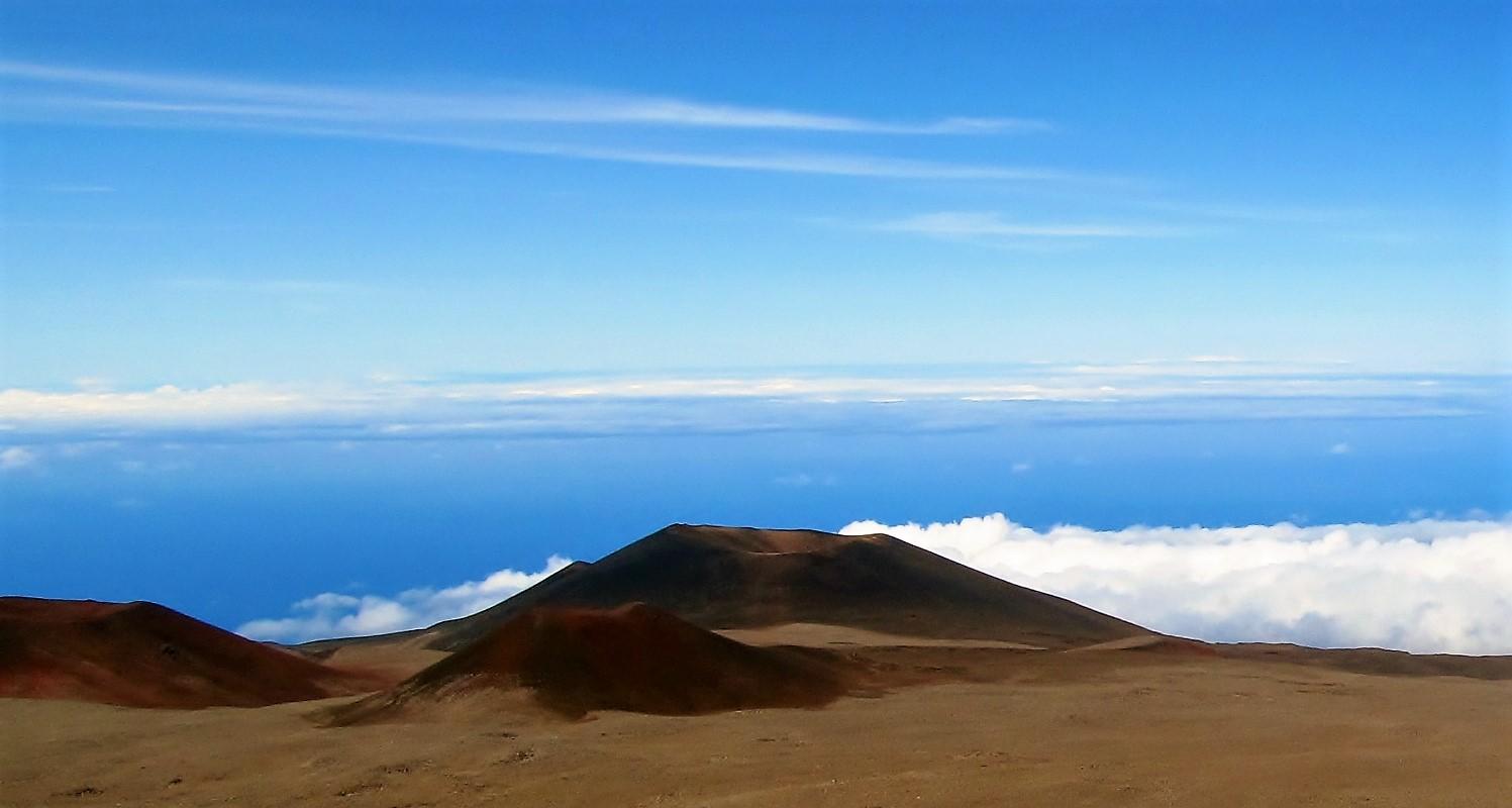 Hawaiian volcanoes rise above the ocean