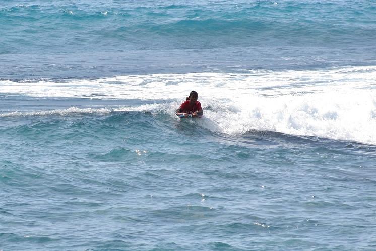 Boogie boarding Wai'aha Bay at Honl's Beach