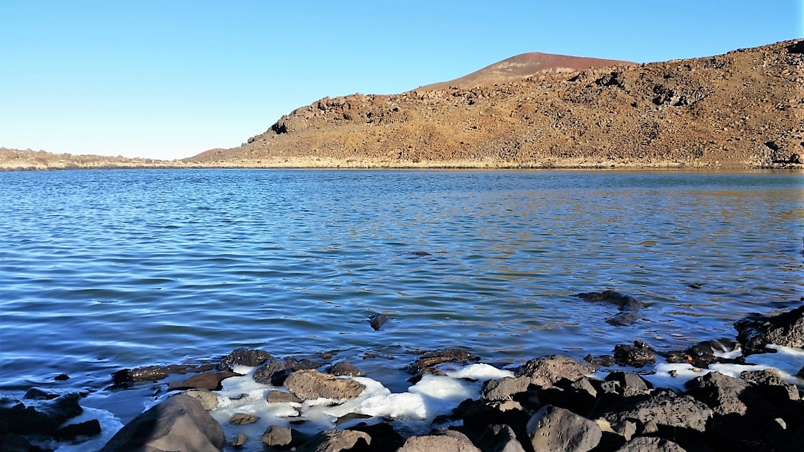 Ice forms along Waiau's shoreline in the cold air of Mauna Kea